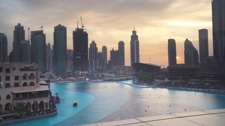 magnífico : Dubai, UAE - April 08, 2018: Modern architecture Downtown Dubai around the Burj Khalifa Lake at sunset stock footage video