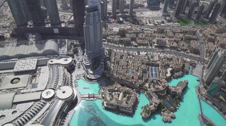 emirados : Dubai, UAE - April 09, 2018: Modern architecture Downtown Dubai and Burj Khalifa Lake at the foot of the tallest building in the world stock footage video