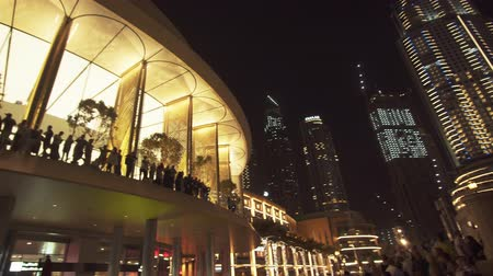 khalifa : Dubai, UAE - April 08, 2018: Dubai Mall building is the worlds largest shopping center at night stock footage video Stock Footage
