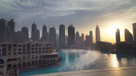 khalifa : Dubai, UAE - April 08, 2018: Dubai Fountain is the worlds largest choreographed fountain system on sunset background stock footage video