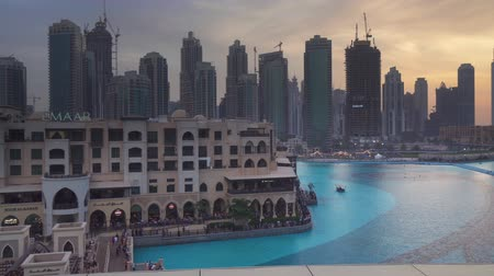 недвижимость : Dubai, UAE - April 08, 2018: Modern architecture Downtown Dubai around the Burj Khalifa Lake at sunset stock footage video