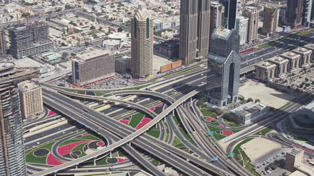 ОАЭ : Dubai, UAE - April 09, 2018: Modern urban multi-level road junctions in Downtown Dubai view from the top stock footage video