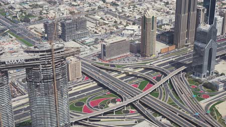 khalifa : Dubai, UAE - April 09, 2018: Modern urban multi-level road junctions in Downtown Dubai view from the top stock footage video