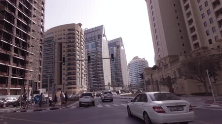 úpadek : Dubai, UAE - April 08, 2018: Journey on the roads among the skyscrapers of the fashionable district Dubai Marina stock footage video