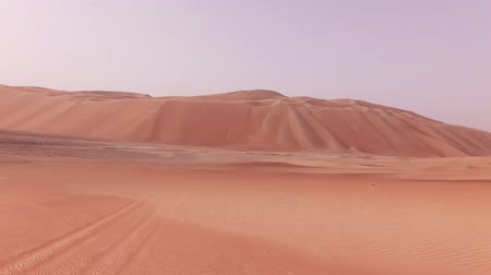 arap : Traveling on an off-road car on the sand of the Rub al Khali desert stock footage video