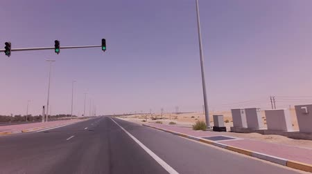 tarmac : Four-way intersection with traffic lights on the highway in the desert stock footage video