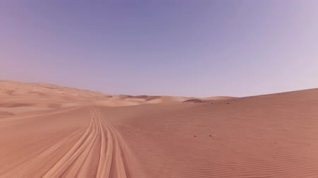 desolado : Traveling on an off-road car on the sand of the Rub al Khali desert stock footage video