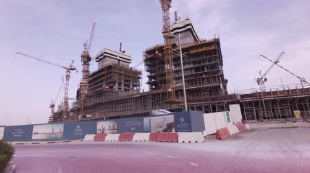félhold : Dubai, UAE - April 08, 2018: Construction of modern hotels on the artificial archipelago Palm Jumeirah stock footage video