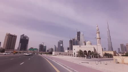 otoyol : Dubai, UAE - April 08, 2018: Car trip on the roads of Downtown with skyscrapers in Dubai stock footage video Stok Video
