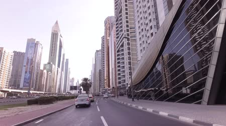 emirados : Dubai, UAE - April 08, 2018: Underground station on the Sheikh Zayed Road with famous skyscrapers in the financial business center of Downtown Dubai stock footage video