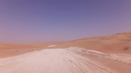 dune : Traveling on an off-road car on the sand of the Rub al Khali desert stock footage video