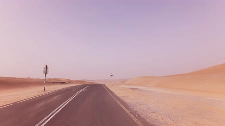 vaha : New road from Oasis Liwa to the Moreeb Dune in Rub al Khali desert stock footage video