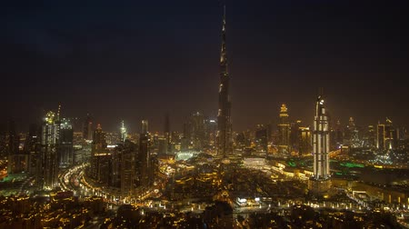 khalifa : Dubai, UAE - April 07, 2018: Burj Khalifa and Dubai Fountain at night Time-lapse stock footage video