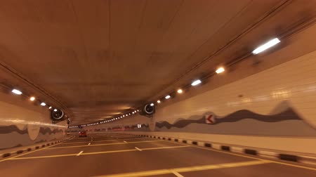 ОАЭ : Dubai, UAE - April 04, 2018: Underwater car tunnel on artificial archipelago Palm Jumeirah stock footage video Стоковые видеозаписи