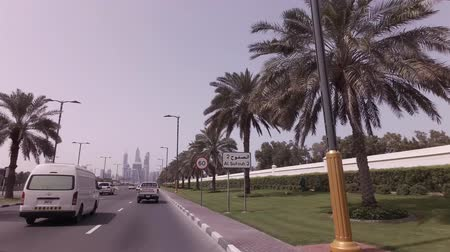 corniche : Dubai, UAE - April 04, 2018: Car trip on elite area Jumeirah in Dubai stock footage video