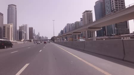 Dubai, UAE - April 04, 2018: Car travel on Sheikh Zayed Road with skyscrapers Dubai Marina stock footage video