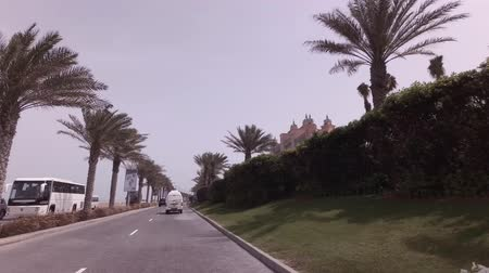 travel theme : Dubai, UAE - April 04, 2018: Car trip to the Atlantis Resort and Theme Park at the Palm Jumeirah Island stock footage video Stock Footage