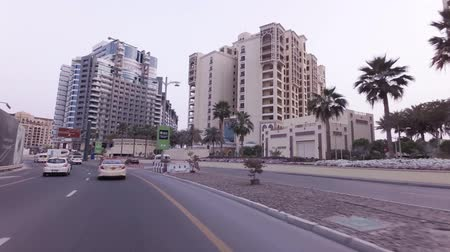 Dubai, UAE - April 04, 2018: Car trip on the roads on the artificial archipelago Palm Jumeirah stock footage video Стоковые видеозаписи