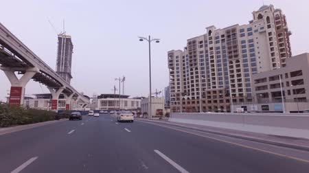 Dubai, UAE - April 04, 2018: Car trip on the roads on the artificial archipelago Palm Jumeirah stock footage video Stockvideo