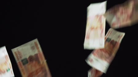 few : Banknotes five thousand rubles fall on a black background slow motion stock footage video