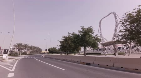 corniche : Abu Dhabi, UAE - April 03, 2018: Car trip to the Ferrari World Yas Island in Abu Dhabi stock footage video