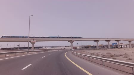 Dubai, UAE - April 03, 2018: Subway train traveling over the overpass in Dubai stock footage video