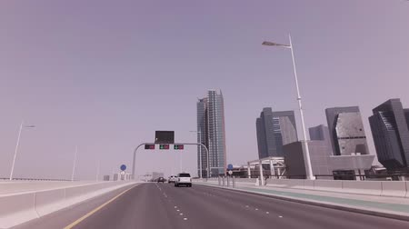 Abu Dhabi, UAE - April 04, 2018: Car trip near the skyscrapers in Abu Dhabi stock footage video Stockvideo