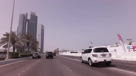 Abu Dhabi, UAE - April 04, 2018: Car trip along The Corniche in Abu Dhabi stock footage video