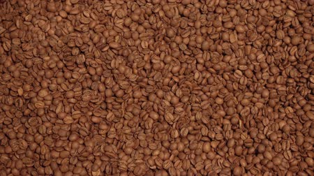 roaster : Dark and aromatic coffee beans the background stock footage video