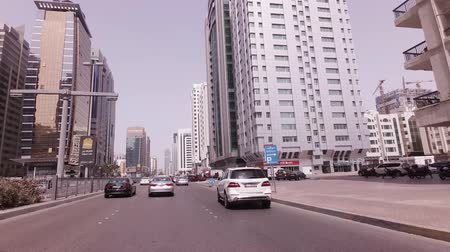 Abu Dhabi, UAE - April 04, 2018: Car trip near the skyscrapers in Abu Dhabi stock footage video Стоковые видеозаписи