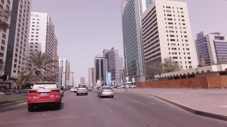 Abu Dhabi, UAE - April 04, 2018: Car trip near the skyscrapers in Abu Dhabi stock footage video Stock Footage