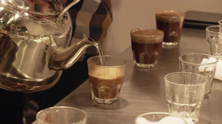 moka : Brewing freshly roasted and ground coffee beans for a sponging stock footage video