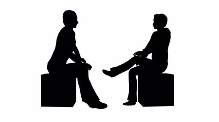 colaboração : Silhouettes of two people sitting and talking on a white
