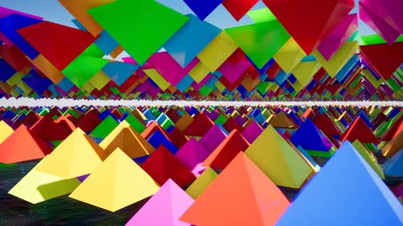 fizik : 3D animation of abstract floating triangles in bright colors. Stok Video
