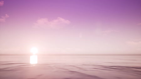 establishing shot : Sunset on tropical clear ocean Stock Footage