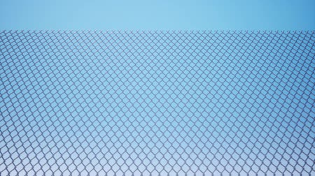 włamywacz : Metal wire mesh against a blue sky Wideo