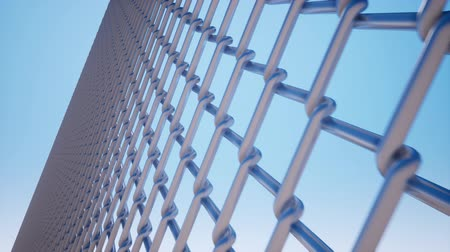 запрещенный : Metal wire mesh against a blue sky Стоковые видеозаписи