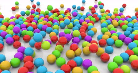 scatters : Colorful plastic balls dropped time lapse footage