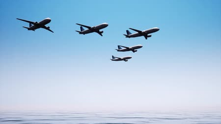 interdiction : Five planes fly strictly in a specific order above the surface of a calm ocean against a cloudless sky. Jamb of planes. Stock Footage