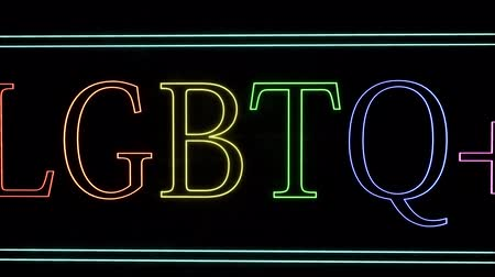 senhor : Neon sign with the inscription LGBTQ plus on a brick wall background. Colorful pride design. Quote lettering. Rainbow background. Vídeos