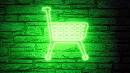 grocery store : Green shopping cart neon blink on brick background. Shopping, offer, discount background.