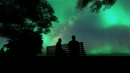 desenhada à mão : Black two men sit bench on white background. Black silhouette.Date under the northern lights