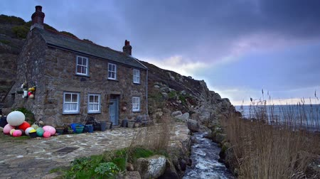 obec : Old fishermans cottage on the South West Coast Path at Penberth Cove, a small fishing village near Penzance in Cornwall