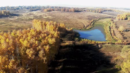 wrzesień : flying over the lake. Autumn landscap