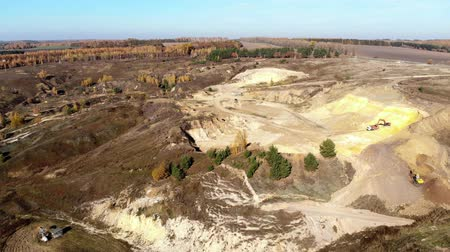 macadam : Flying forward over sand quarry with excavators. Aerial view. Stock Footage