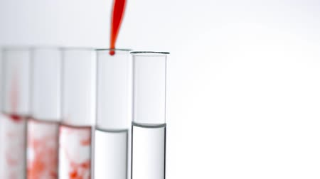 отцовство : A pipette drips blood into a test tubes