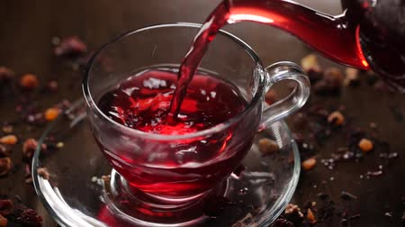 hibiscus tea : Hibiscus tea pouring into transparent glass