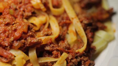 cooks : Eating plate of spaghetti Stock Footage