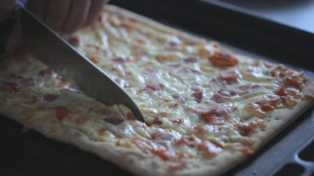 cheese slice : Cutting pizza on the baking tray Stock Footage
