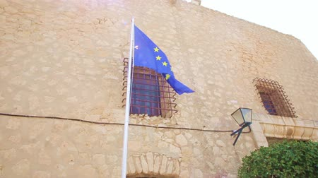 brexit : Flag of European Union on the background of a wall with windows and bars in the castle of Santa Barbara